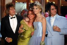 Taylor Swift (blue) poses with her band members Paul Sidoti, Caitlin Evanson and Grant Mickelson at her prom-themed No. 1 party in 2008.