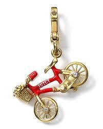 YJRU5589 Tagged Name: Bike Charm MSRP:  52.00 Box: Hot pink w. magnetic closure and black satin interior Clasp: Gold Released in 2012  Description Red bicycle with a gold basket full of flowers.