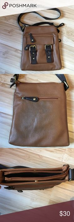 """✨Leather cross body This gorgeous brown and chocolate leather cross body is perfect for any occasion. Great condition with some blue dye marks on backside of bag, see 2nd pic, from using with jeans. All zippers and metal latches work great! Tons of compartments! It's the ideal bag for a gal on the go! Bag is 11"""" tall, 9.5"""" wide, strap is roughly 45"""" long. Bass Bags Crossbody Bags"""