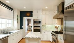 white kitchen with blue walls