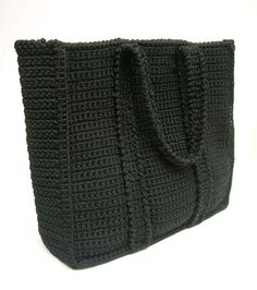 Basic black bag pattern. A crocheted bag everyone can make. Created for beginners, includes basic stitches and shaping. Row by row guidance.