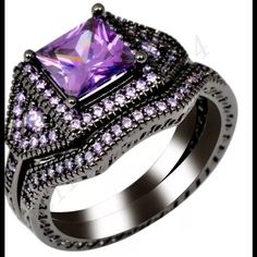 Black Gold Purple Amethyst White Topaz Ring Size 7  Brand new with tags  Never worn  Beautiful 2 Carat center stone Amethyst  Gemstone surrounded by white topaz  Black gold filled & stamped  Wrapped and shipped with care Fire and Ice  Jewelry Rings