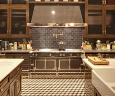 Fabulous kitchen beginning with La Cornue stove and wall & floor tile from The Perfect Bath.