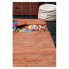 sandbox built into deck.  Brilliant in the pacNW since you have to keep 'em covered anyway...