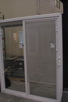 Our Vinyl Sliding Patio Door W/ Blinds Between The Glass.