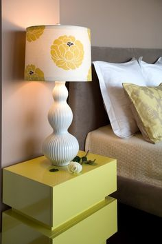 Lampshades. A big trend is to bring color and pattern into a room through lampshades, and this is a gorgeous example. Such an approach to bringing in bold pattern requires very little commitment, and is therefore a great place to start if not accustomed to living with bold pattern.