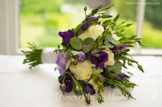 101 Bridal Bouquets designed by Jack Haddon.  Hand Tied bouquet consisting of Purple Lizianthus, Avalanche Roses and Lilac Freesia.