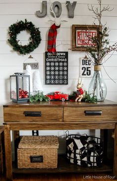 This entryway design has everything you're looking for in holiday decor. From the charming knit-knacks and festive Christmas quotes to the cozy color scheme of a seasonal wreath, this decoration inspiration has it all.