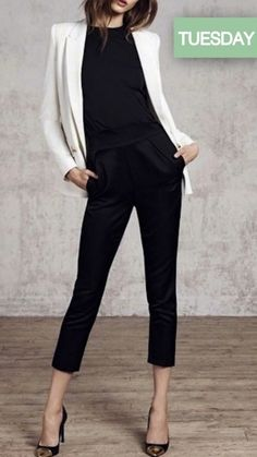 Professional style -- black blouse, black trousers, black / cap-toe pumps, white blazer -- work outfit