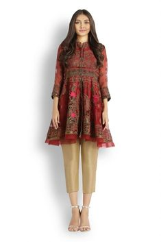 This eid wear this beautiful red colored peplum top in organza.  This top is heavily embroidered all over.