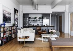 I really like this--the industrial elements of the space, the range in the palette, the collection of pieces.