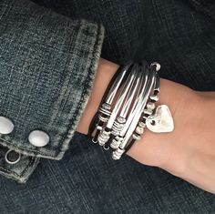 Double Love leather wrap bracelet shown in Natural Black Leather with Hammered Heart Charm.  Goes perfectly with denim!  Perfect for any season . . . any place!