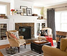 Stone Fireplace, striped rug, love the neutral furniture with elements that pop being so easy to update!