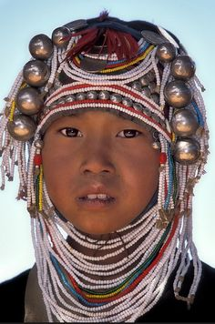 *Young Akha woman, Burma (Myanmar) a sovereign state in Southeast Asia bordered by China, Thailand, India, Laos and Bangladesh.