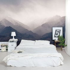 Bed on floor with wall mural