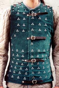 A brigandine...worn most by archers and foot soldiers...oblong plates were bradded onto cloth and worn over mail.