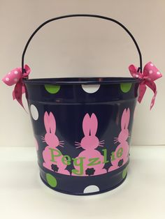 This adorable navy metal bucket is perfect for Easter to use as an Easter basket, gift, or for your little one to use hunting for Easter eggs. Also a great gift to hold books and other small toys.  -- D E T A I L S -- Dimension: 9 inches high x 11 inches diameter/ 10 quart bucket Metal bucket Customized with outdoor waterproof vinyl Girl buckets with come with bows on the handle Order design as shown-- or custom designs available, message us for details.  --C H E C K O U T I N S T R U C ...