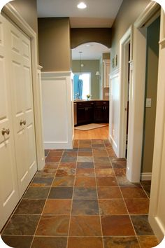 """The floor is 12"""" x 12"""" tiles of natural slate from Daltile. Paint color is Benjamin Moore; Texas Leather AC-3. This was used in the back hall, foyer, and master bath & closet. It's a perfect neutral - not too warm, and not too cool. It looks great against the white woodwork & wainscoting."""