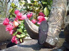 little dancing shoes at the grave of Vaslav Nijinsky, Montmartre cemetery, Paris.