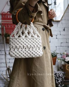 - Image may contain: people standing Macrame Purse, Macrame Knots, Macrame Jewelry, Incheon, Crotchet Bags, Knitted Bags, Macrame Toran, Macrame Design, Baby Girl Crochet