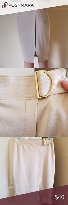 """NEW Beige Asymmetrical Suede Buckle Pencil Skirt 4 NEW W/ TAGS. Softest faux suede that has a luxurious feel on the skin, in a neutral, creamy beige color for sz 4-6.  Asymmetrical split hem w/ an elegant, gold D-ring buckle (decorative so no unbuckling necessary).  The wrap-like design & resulting slit does not actually open up so no risk of flashing too much leg at the office.  Side zipper.  Fully lined in silky poly satin.    Waist: 14"""", hips: 18"""", length: 23"""". The Limited Skirts Pencil"""