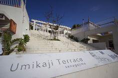 Umikaji terrace Senagajima in Okinawa. Whitewashed buildings looking out over the ocean.