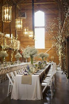 """a few things I love about this...  tree branches with white lights, simple """"low"""" table decorations like candles and small arrangements in mason jars, and """"tall"""" bunches of baby's breath for drama."""