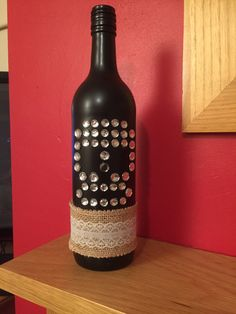 Bottle sprayed with Black spray paint decorated with Skull in beads and lace .. Special pressie for my Daughter xx