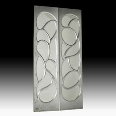 "Lot 1037 - Phil Powell Pair of doors, New Hope, PA, 1960s Silvered wood, mirrored glass, chromed hinges  Unmarked  96"" x 23 1/2""  $3,000 - $4,000"