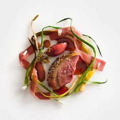 The duck in this dish is one of the only recipes I feel I've truly perfected and it remains on our menu season after season. Duck, honey lavender glazed w/ rhubarb and spring onions