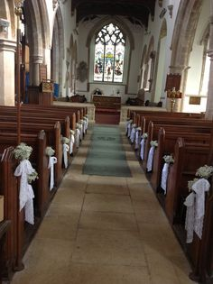 Hallaton church, Leicestershire decorated with gypsophila pew ends with lace bows ... Simple and so effective