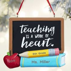 Teacher's Chalkboard Personalized Teacher Ornament Skillfully laser engraved with any text on the pencil & book and the year on the apple Handcrafted of colorful resin with detailIncludes ribbon for easy hangingOrnament measures Teacher Wreaths, Teacher Ornaments, Teacher Christmas Gifts, School Wreaths, Personalized Teacher Gifts, Personalized Christmas Ornaments, Personalized Wedding Gifts, Pink Christmas Ornaments, Christmas Time