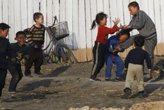 North Korean children tussle along the North Korean banks of the Yalu river on Sunday, April 5, 2009. (AP Photo/Ng Han Guan) # - See more at: http://www.boston.com/bigpicture/2009/04/peering_into_north_korea.html#photo32