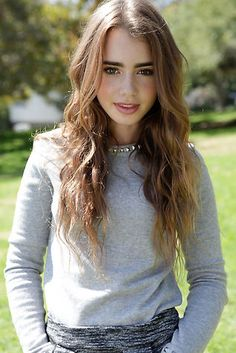 lily collins. She's my new favourite. It's sad that I saw her first in Mirror Mirror and hated her because she's actually a really good actress and she's beautiful, even if her eyebrows get a bit out of control sometimes!
