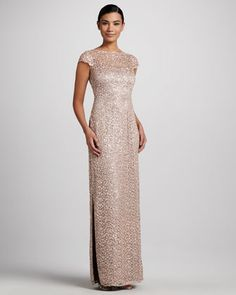 Kay Unger New York has created a captivating gown using an overlay of intricate lace, sparkly sequins and metallic highlights. At Neiman Marcus $595.00