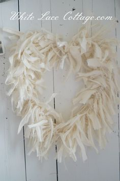 DIY Simple Valentine Heart Wreaths - White Lace Cottage  (wire hanger, or wire, shaped into a heart, with muslin torn into strips and tied the wire. she also adds bumpy yarn to another one, which I like just as well!)