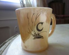 My gran had almost a similar mug...more deeper color and not the same shape, but very close❥ ....glasbake mug with orange pearl coating vintage - Google Search