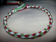 12 strand kumihimo bracelet; red, green and white