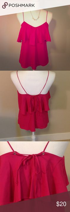 Hot pink satin tank Hot pink ruffle top satin tank with tie string back detail. Perfect alone over skinnies in warmer weather or pair with a jean jacket, mini skirt and knee high boots for cooler months! Gently loved with two small discolorations in ruffle, see photo 4. luna Tops Tank Tops