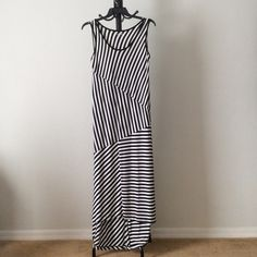 "✨4/24 HP ✨NWT Black & white dress Full length high-low dress. Sleeveless. 95% rayon; 5% spandex. Measuring from back, length approximately 57.5"". Note: Color flaw on side of dress present at purchase. Discovered when taking measurement of dress (see last pic) qufrzouq Apt. 9 Dresses"