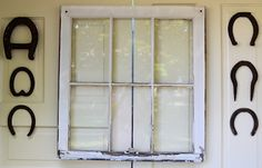 Shabby Love: Patio space. Old window and horseshoes.