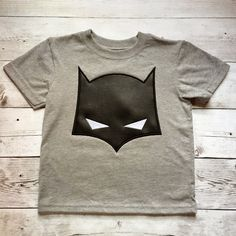 Batman Cowl Mask Applique Design INSTANT DOWNLOAD for DIY projects, from Designed by Geeks. Use any embroidery machine - Brother, Viking, Janome, Bernina, Pfaff, Singer - to stitch this design.  The applique Gotham needs. This applique features a bat mask with eyes. Great for a hooded towel.