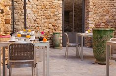 A hotel for instant relaxation. The Maison d'Ulysse : a historic farmhouse, located in the South of France, and dates far back to the Outdoor Furniture Sets, Outdoor Decor, Organic Vegetables, South Of France, Source Of Inspiration, Rustic Charm, Oh The Places You'll Go, Outdoor Gardens, Interior Design