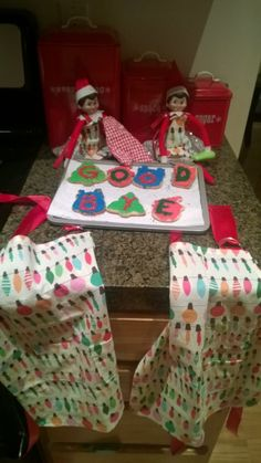 They made cookies and decorated them to say goodbye to the girls, but also left aprons to wear for when we make cookies for Santa.  Thanks elves - you have some serious sewing skills.