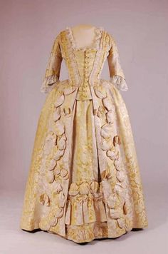 Robe à la francaise, 1770-1780. Yellow and cream striped chinese silk damask, fabric trim.