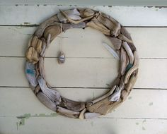 A driftwood wreath made of objects found on the shores of  Lake Superior by Seven Sisters.