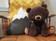 Outdoor themed nursery. (I love the lil bear and mountains!!)