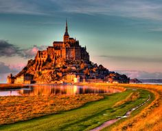 The imposing monastery of Mont Saint-Michel is reachable by a natural footpath only when the surrounding waters recede at low tide.