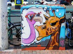 Street Art - Flamingo and Giraffe on Brighton seafront.