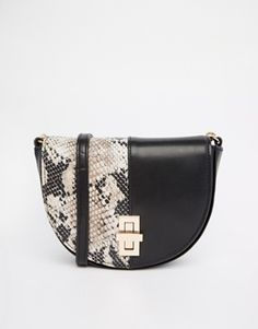 Snake skin is sooo totally seventies, so obvz i'm in love with this bag!